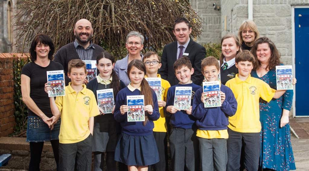 """GWR-From left, Melissa Muldoon, Headteacher Mr Iannis Ireland, Celia Minoughan from the Devon and Cornwall Railway Trust, Station Manager Nicholas Reid and Author Susan Quayle, with pupils at Starcross Primary School in Devon, after the launch a new book called, """"The Seaside Train"""". 23/03/2016"""