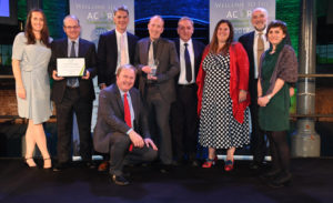 Devon and Cornwall Rail Partnership team and partners on stage at the Community Rail Awards